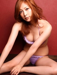 Natsuko Tatsumi with big cans showers body over clothes