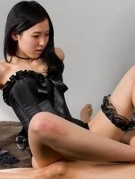 Corset-clad hottie Natsuki Yokoyama using her feet to get a horny dude off