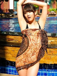 Shou Nishino is playful at the pool and exposes sexy legs