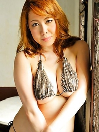 Yumi Kazama shows big boobs in tiny bra around the house