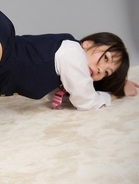 Yuma Miyazaki posing in a uniform and teasing her pussy with a vibrator
