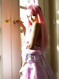 Sexy gravure idol babe naked in a cute pink wig and maid costume