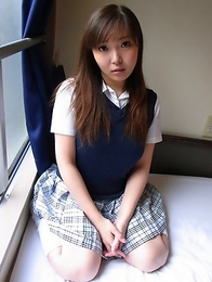 Haruka Ohsawa posing in her schoolgirl uniform and hiking up her top to show her big boobs