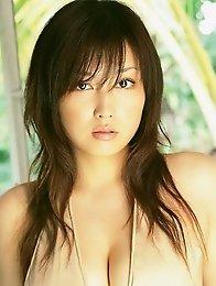 Sensual gravure idol babe seduces in skimpy cream lingerie