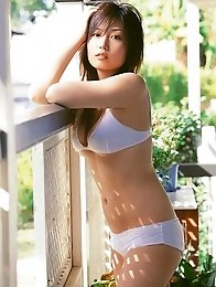 Gorgeous asian beauty seduces as she hides her plump tits