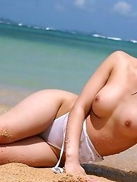 Azusa Kyouno at the beach posin big round tits