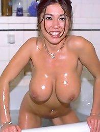 Sexy big tits asian babe posing