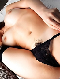 Reina Fujii is having fun during the erotic photo session